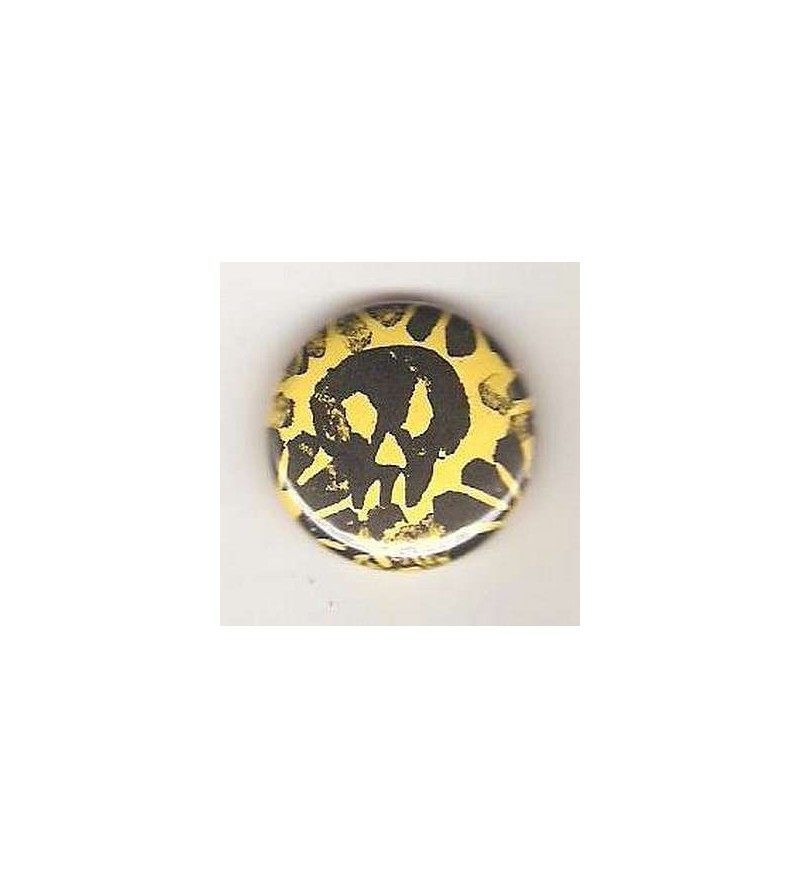 Badge jaune linogravure petit crâne et fleurs