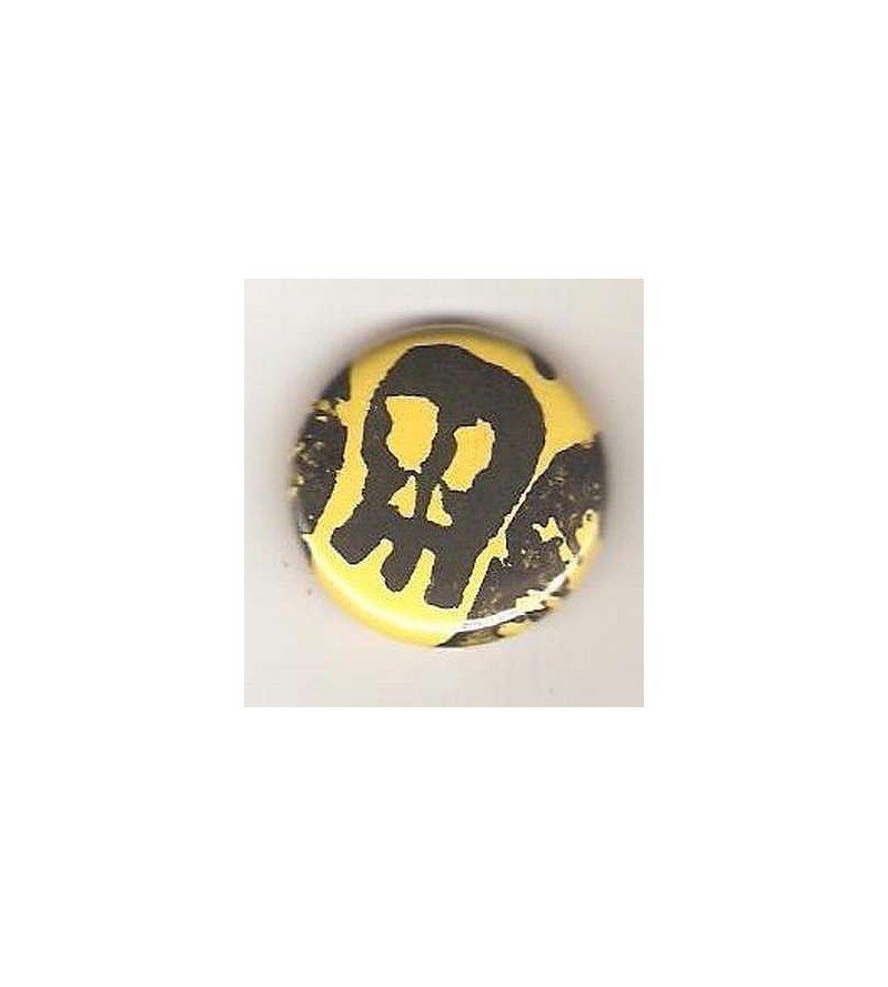Badge jaune linogravure crâne allongé