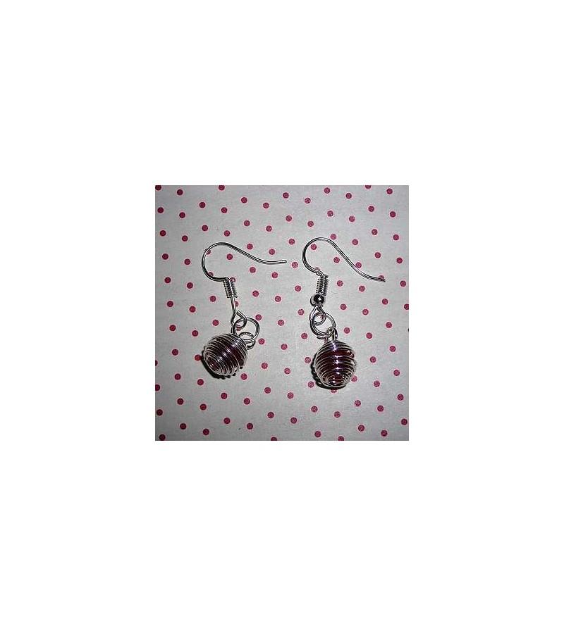 Paire de boucles d'oreilles perle de cornaline en cage argentée